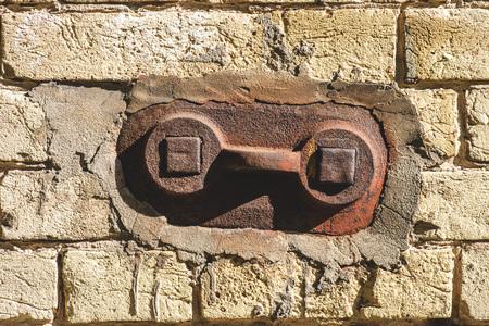 grey brick wall with old metallic handle