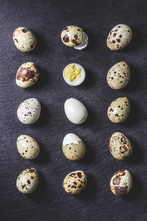 top view of healthy boiled quail eggs on black background