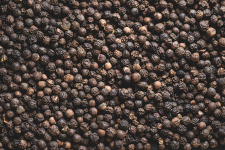full frame view of dried aromatic peppercorns background