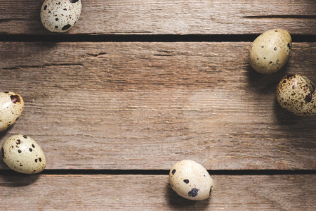 top view of raw healthy organic quail eggs on wooden table Stock Photo
