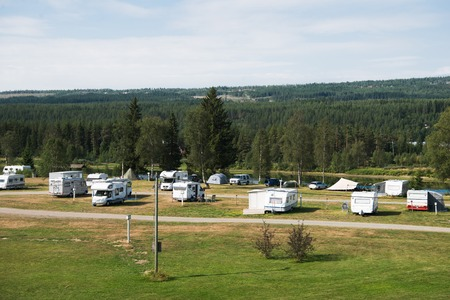 TRYSIL, NORWAY - 26 JULY 2018: aerial view of parked trailers near forest in largest ski resort Trysil, Norway Editorial
