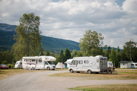 TRYSIL, NORWAY - 26 JULY 2018: parked trailers near mountains under cloudy sky at largest ski resort in Norway