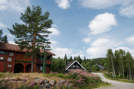 TRYSIL, NORWAY  - 26 JULY 2018: living houses under cloudy blue sky at largest ski resort Trysil in Norway