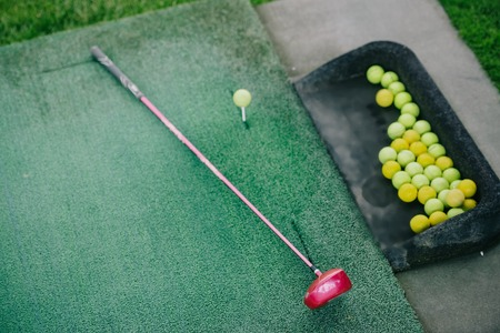 top view of arranged golf club and balls on green lawn Stok Fotoğraf
