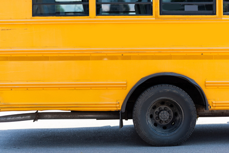 side view of traditional yellow school bus