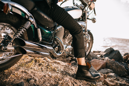 low section view of biker sitting on classic motorcycle