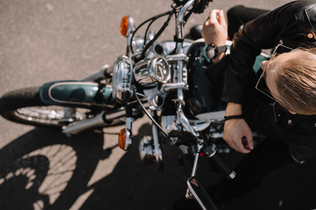 overhead view of biker sitting on vintage classical motorcycle 스톡 콘텐츠