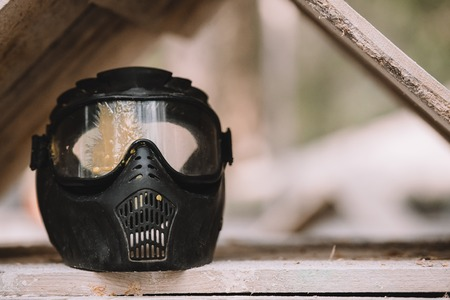 close up view of goggle mask covered by paintball splash outdoors Фото со стока