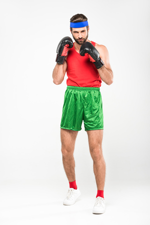 man in retro sportswear and boxing gloves, isolated on white