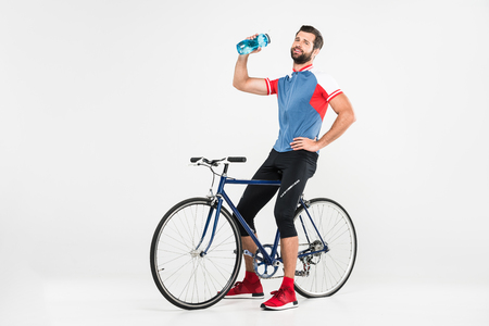sportsman with bicycle holding sport bottle, isolated on white Imagens