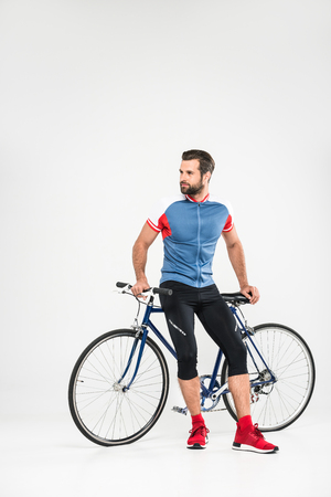 handsome bearded sportsman with bicycle, isolated on white