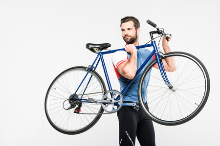 bearded sportsman carrying bike, isolated on white Stock Photo