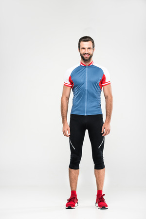 smiling cyclist standing in sportswear, isolated on white Reklamní fotografie