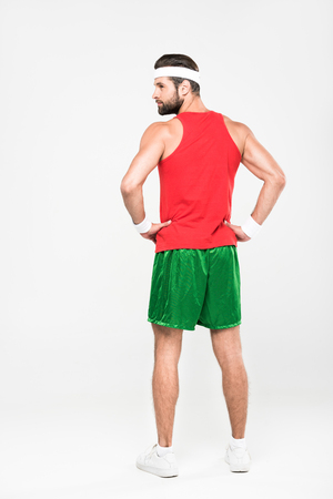 rear view of sportsman posing in retro sportswear, isolated on white Stock Photo