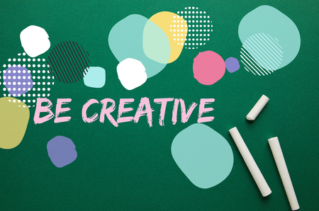 top view of white chalks on green blackboard with be creative inspiration Imagens