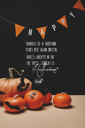 pumpkins, paper bats and paper garland with word happy and halloween poem