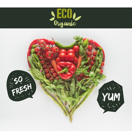red and green heart shaped vegetables isolated on white with eco organic lettering