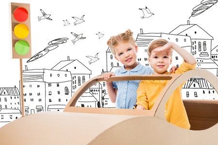 siblings playing with cardboard car and traffic lights in drawn city with birds Banque d'images - 109218197