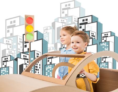 happy siblings playing with cardboard car and traffic lights in drawn city Banque d'images - 109218200