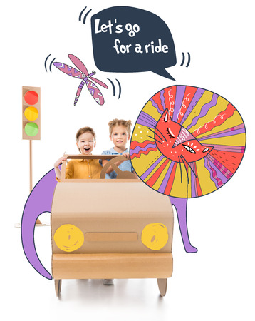 excited adorable children driving cardboard car with traffic lights with drawn lion and Let go for a ride lettering Stock Photo