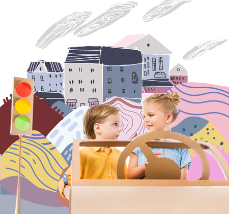 adorable children driving cardboard car with traffic lights in drawn city Stock Photo