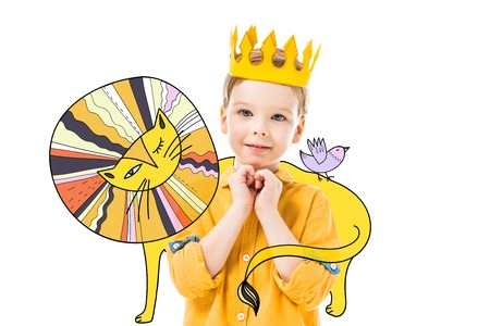 adorable boy in yellow crown with please gesture, isolated on white with colorful drawn lion and bird Reklamní fotografie