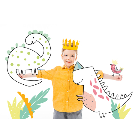 happy boy in yellow crown with imaginary dinosaurs on outstretched hands isolated on white 版權商用圖片
