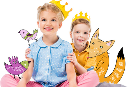 adorable children in yellow paper crowns, isolated on white with drawn imaginary fox and birds Фото со стока