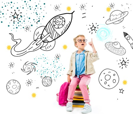 excited schoolchild pointing up and having idea while sitting on pile of books with backpack isolated on white with fantasy universe, spaceships and planets