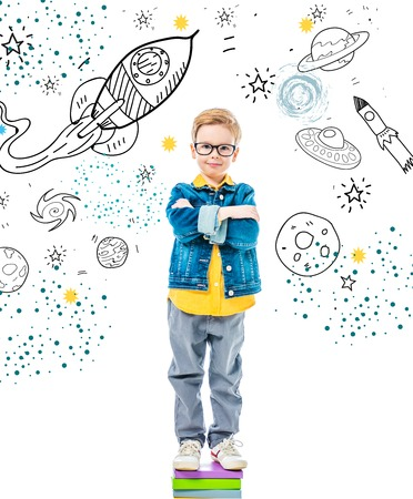 pupil with crossed arms standing on pile of books, isolated on white with space, stars and planets Standard-Bild - 109218397