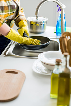 cropped image of woman washing frying pan in kitchen 写真素材