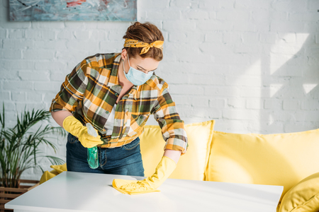 beautiful woman cleaning table at home Stock Photo