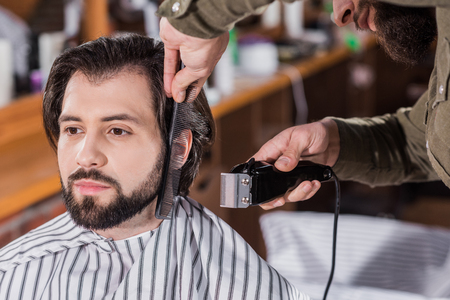 close-up shot of barber shaving man with Hair Clipper Фото со стока - 109417215
