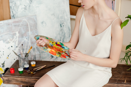 cropped shot of tender young female artist holding palette in studio Stok Fotoğraf