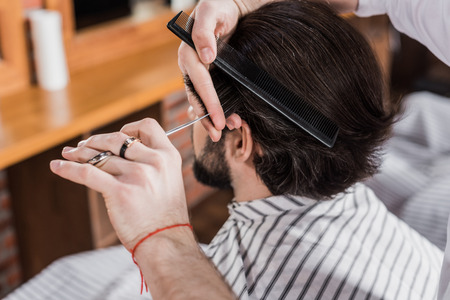 close-up shot of man getting haircut in barbershop Фото со стока - 109464720