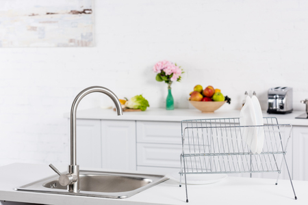 close up of sink and stand for dishes on kitchen Stock Photo