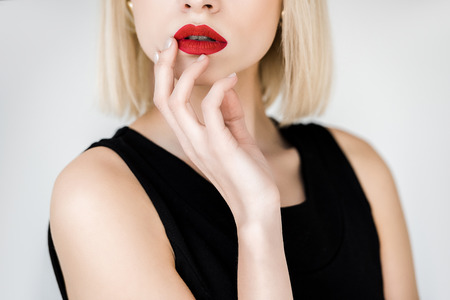 cropped image of stylish blonde woman with red lips isolated on white