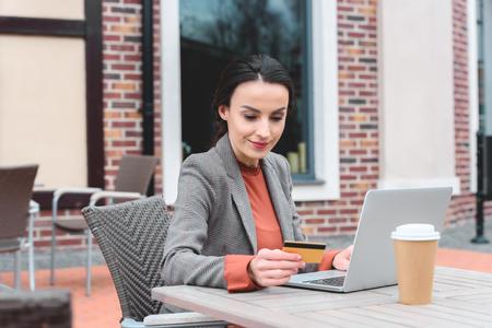 beautiful stylish woman shopping online with laptop