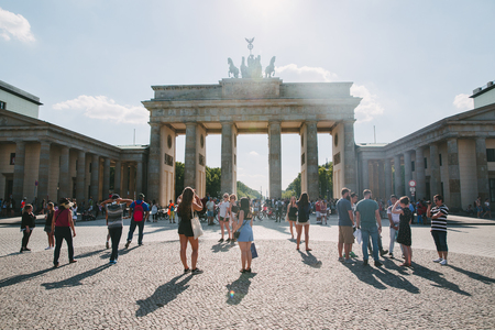 BERLIN, GERMANY - JUNE 20, 2017: urban scene with tourists on city square and Brandenburg gate in Berlin, Germany