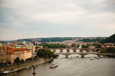 PRAGUE,CZECH REPUBLIC - JUNE 23, 2017: view of bridges and boats on Vltava river in Prague, Czech Republic