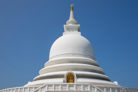 UNAWATUNA, SRI LANKA - JAN 17, 2017: view of dome of ancient religious temple against blue sky in Asia Editorial