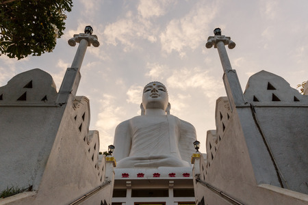 KANDY, SRI LANKA - JAN 17, 2017: low angle view of religious monument with cloudy sky on background, Asia