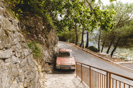 SAINTE AGNES, FRANCE - 17 SEPTEMBER 2017:  parked vintage car on road in mountains, Sainte Agnes, France Editorial