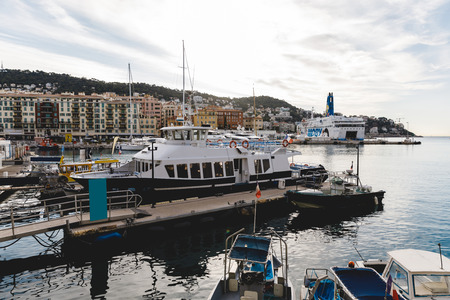 NICE, FRANCE - 17 SEPTEMBER 2017: lot of ships standing in harbour of old european city located on seashore
