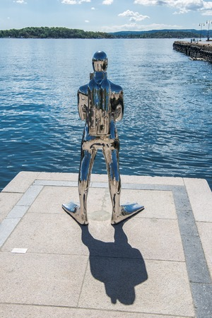 OSLO, NORWAY - 28 JULY, 2018: back view of contemporary sculpture of diver in Oslo harbour 에디토리얼