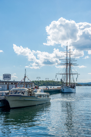 OSLO, NORWAY - 28 JULY, 2018: boats moored in harbour at Aker Brygge district, Oslo