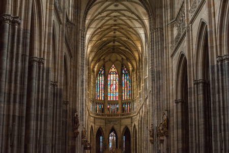 PRAGUE, CZECH REPUBLIC - JULY 23, 2018: beautiful ancient stained glass windows inside st vitus cathedral in prague, czech republic 新闻类图片