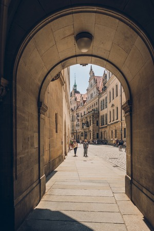 PRAGUE, CZECH REPUBLIC - JULY 23, 2018: archway and people walking on street in old town, prague, czech republic