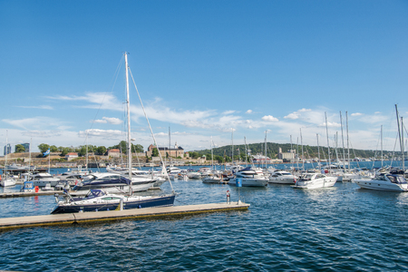 OSLO, NORWAY - 28 JULY, 2018: boats and yachts in harbour, Aker Brygge district, Oslo Sajtókép