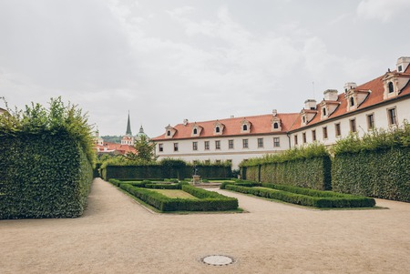 beautiful old architecture, buildings and green bushes in prague, czech republic
